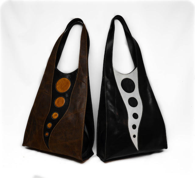 Two leather Chemical Wedding Handbag totes in brown, mustard and black and white