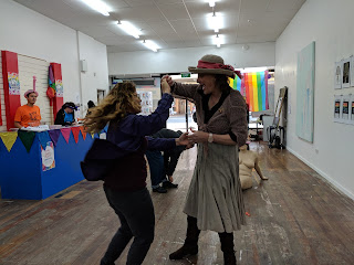 Dancing at a pride event in an art gallery