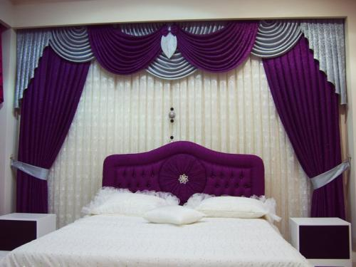 curtains for bedroom windows located behind the bedset and headboard