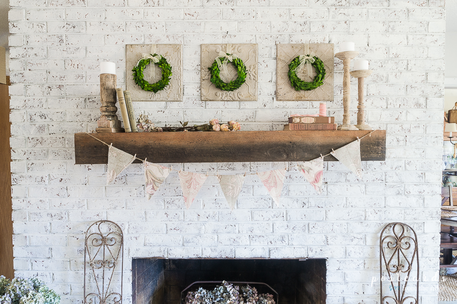 white brick fireplace with vintage cottage decor