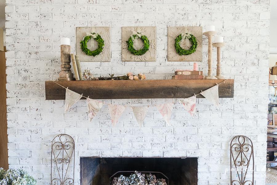 white brick fireplace with vintage cottage decor
