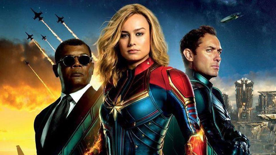 Captain Marvel movie poster, showing Brie Larson as Carol Danvers, Samuel L. Jackson as Nick Fury, and Jude Law as Yon-Rogg