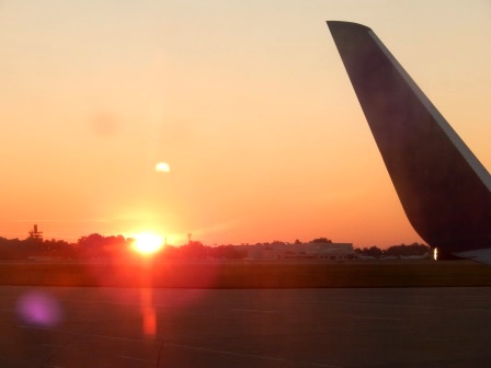 Morning sunrise behind a airplane tail