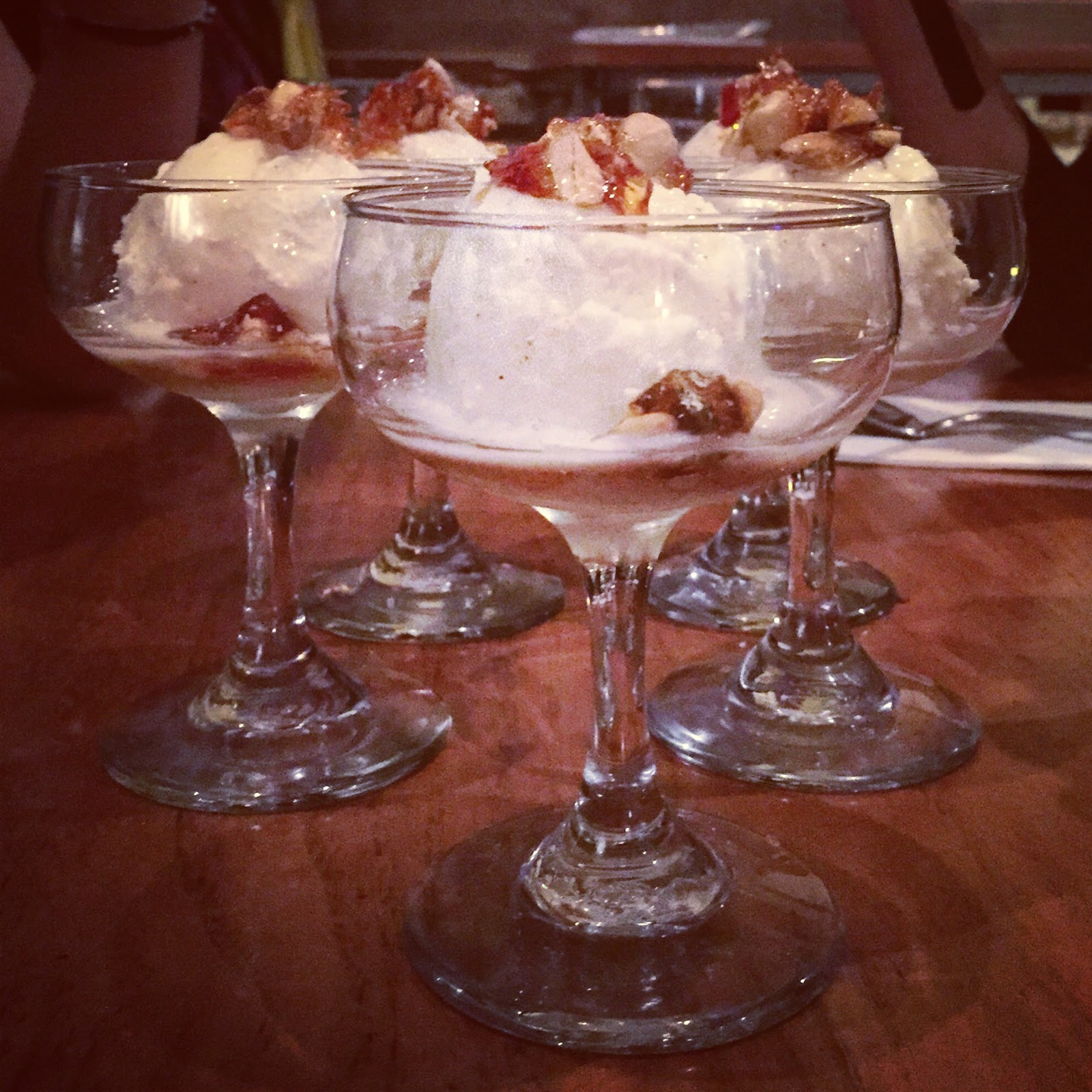desserts with peanut brittle in cocktail glasses