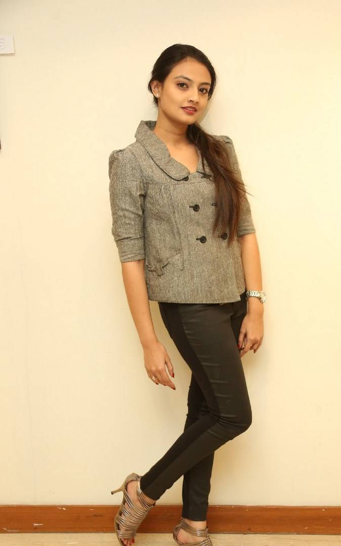 Tollywood Actress Nikitha Narayan Hot Long Hair Stills In Black Coat Jeans