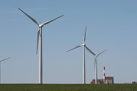 Wind turbines accompany Exelon's nuclear power plant near Marseilles, Illinois. A state law helps support both nuclear and renewable energy. (Credit: Scott Olson/Getty Images) Click to Enlarge.