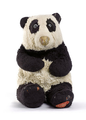 photo of old stuffed panda bear