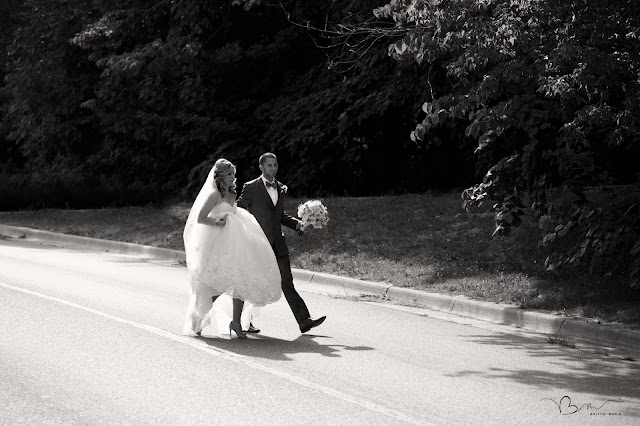 bride and groom walking at Noah's Event Venue in Auburn Hills Michigan