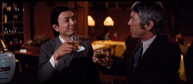 James Hong and James Coburn in The Carey Treatment (1972)