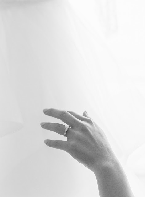an elegant shot of Jin's engagement ring