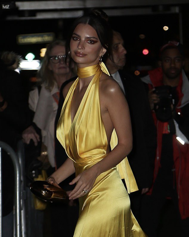 Emily Ratajkowski flaunts her cleavage in yellow dress as the model makes her way to Marc Jacobs wedding