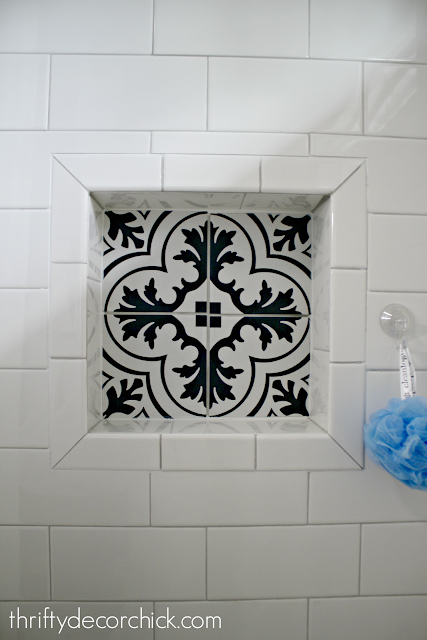 Cement tile niche in shower