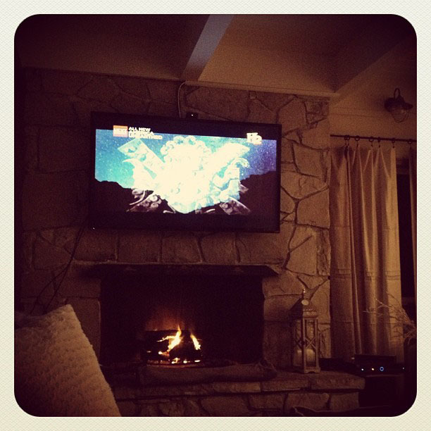 watching tv above the fire