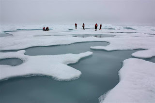 Scientists on Arctic sea ice in the Chukchi Sea, surrounded by melt ponds, July 4, 2010. (Image Credit: NASA/Kathryn Hansen) Click to Enlarge.