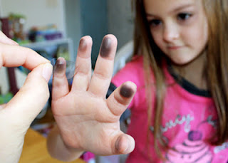 After creating an ink pad of sorts by heavily coloring with pencil onto scrap paper, Tessa rubbed her fingertips along the leaded spot until they were sufficiently coated with graphite. Then, I used pieces of transparent tape to lift her fingerprints and adhere them to the lab sheet.