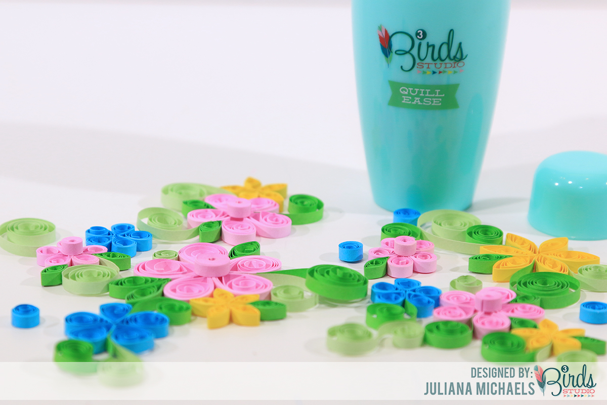 Quilled Flowers created by Juliana Michaels using the 3 Birds Design Quill Ease Quilling Tool #3birdsdesign #quillease #quilling