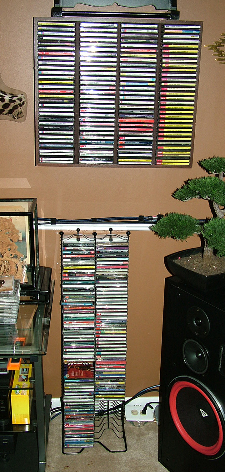 Above Is The Wall Mounted Wooden Rack And Floor Standing Wire That Held Classical CDs Prior To New Rotating 300 CD