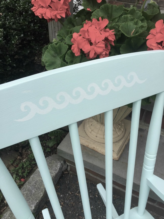 stenciled top of rocking chair with waves