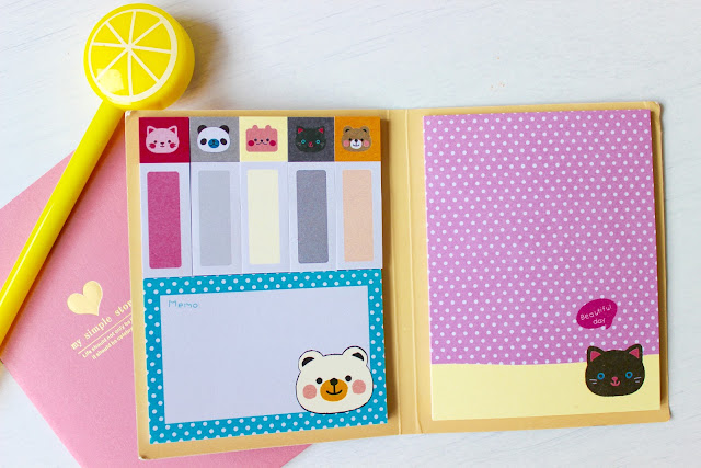 notebook, sticky notes, pens, stationary