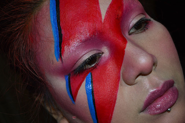 a picture of a david bowie aladdin sane makeup