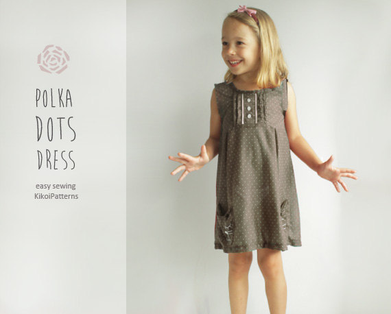 ac52cd6f3481 Take advantage of this offer to make this lovely summer dress with cat  motif for your little girl. Pattern info