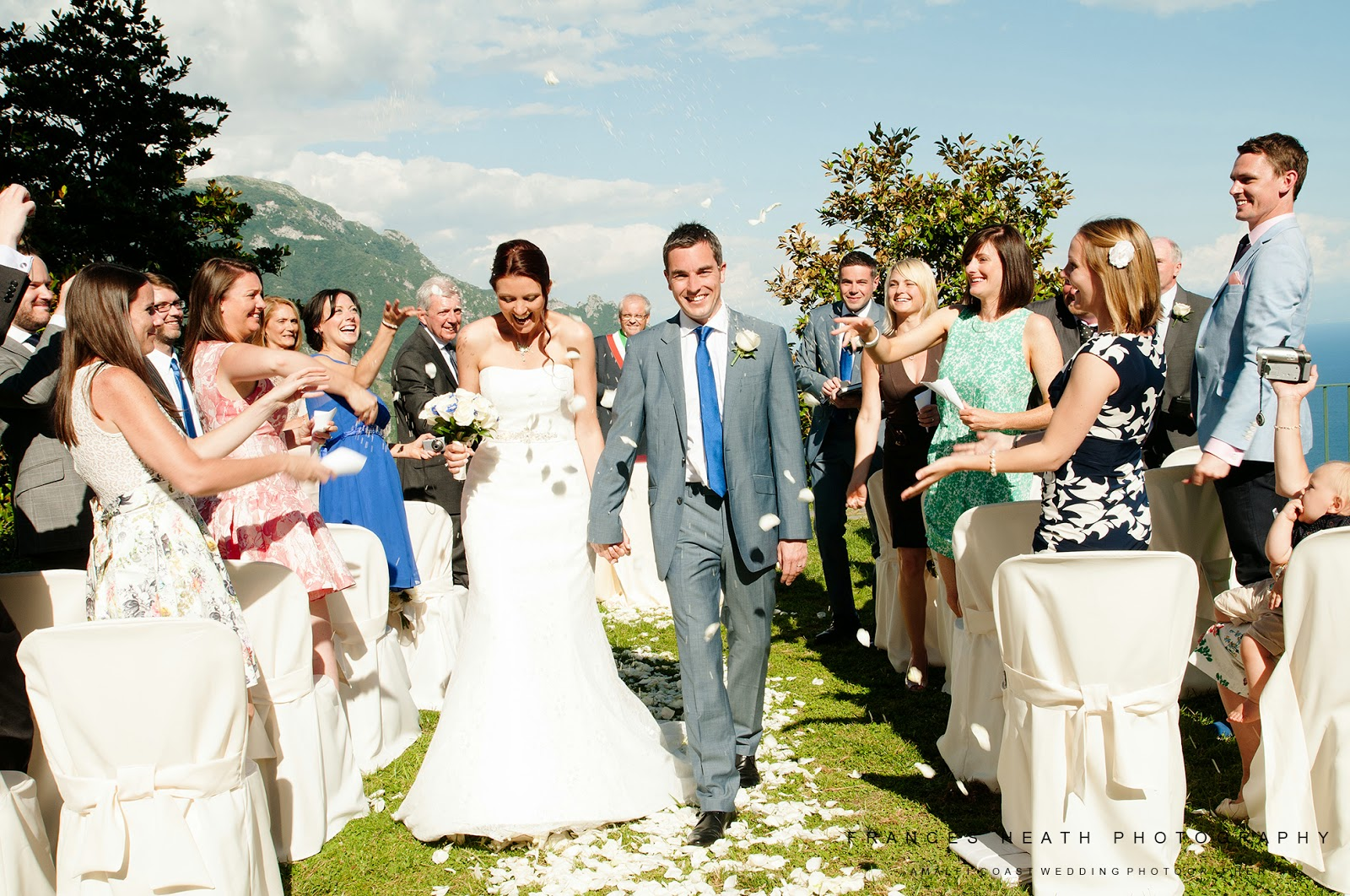 Wedding guests throwing confetti at the town hall in Ravello