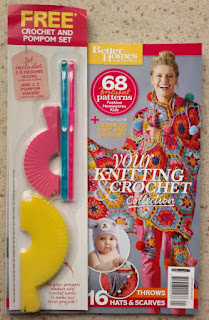 Front cover of the magazine with crochet hooks and pom pom makers packaged on the front.