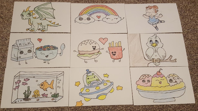 Hand Drawn Postcards, a dragon, clouds and a rainbow, a ballerina, a carton of milk and cereal bowl, hamburger and fries, a bird in a tree, a fish tank,an alien in a space ship and a banana split