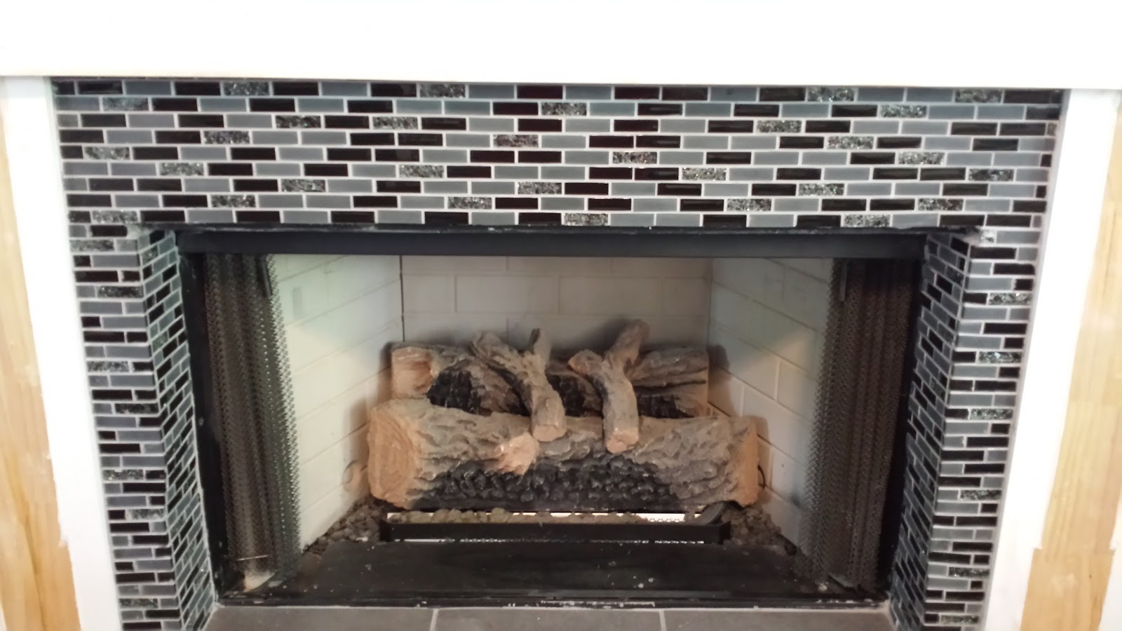 deck our home fireplace before and after