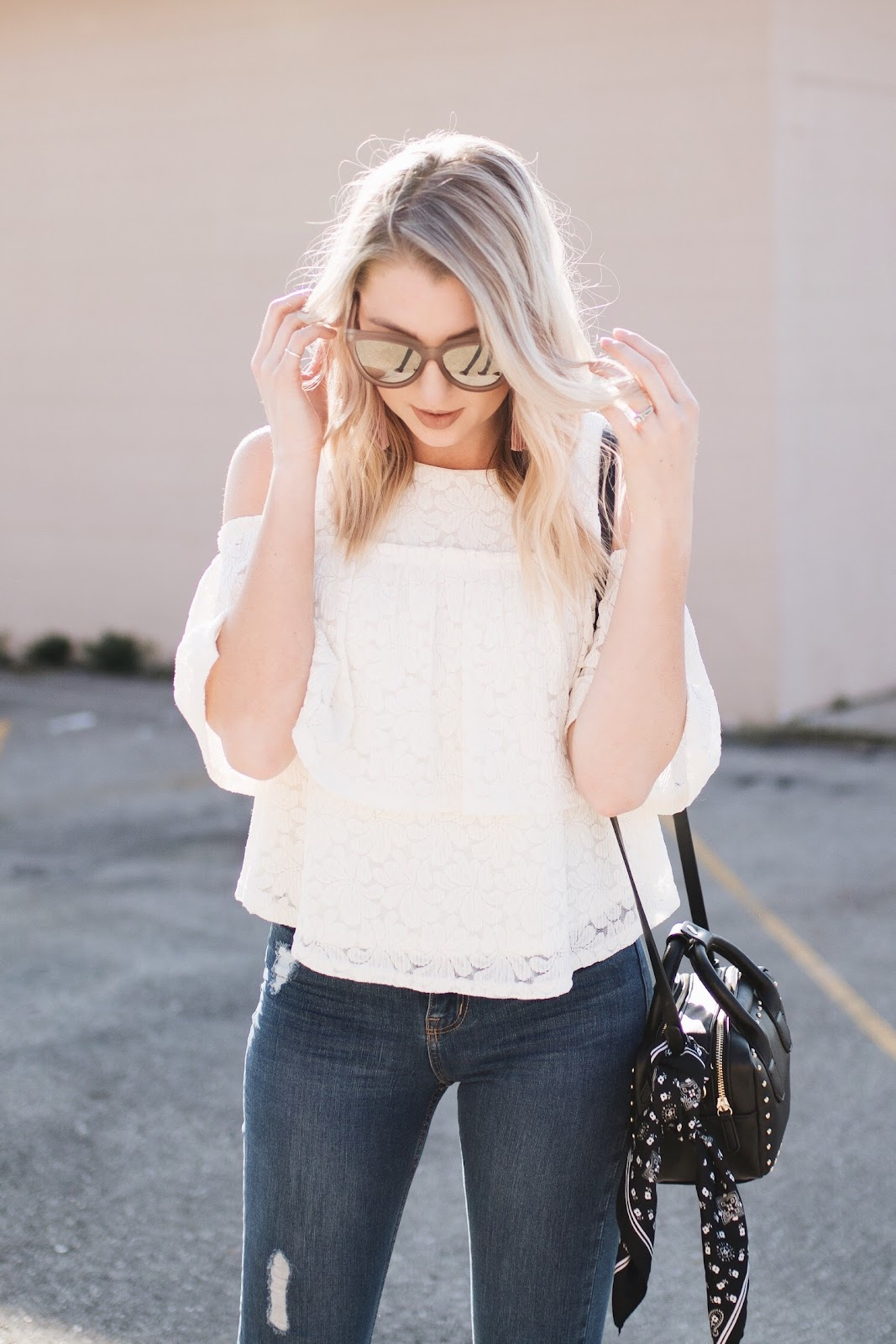 cream lace top, tan sunglasses, pink earrings