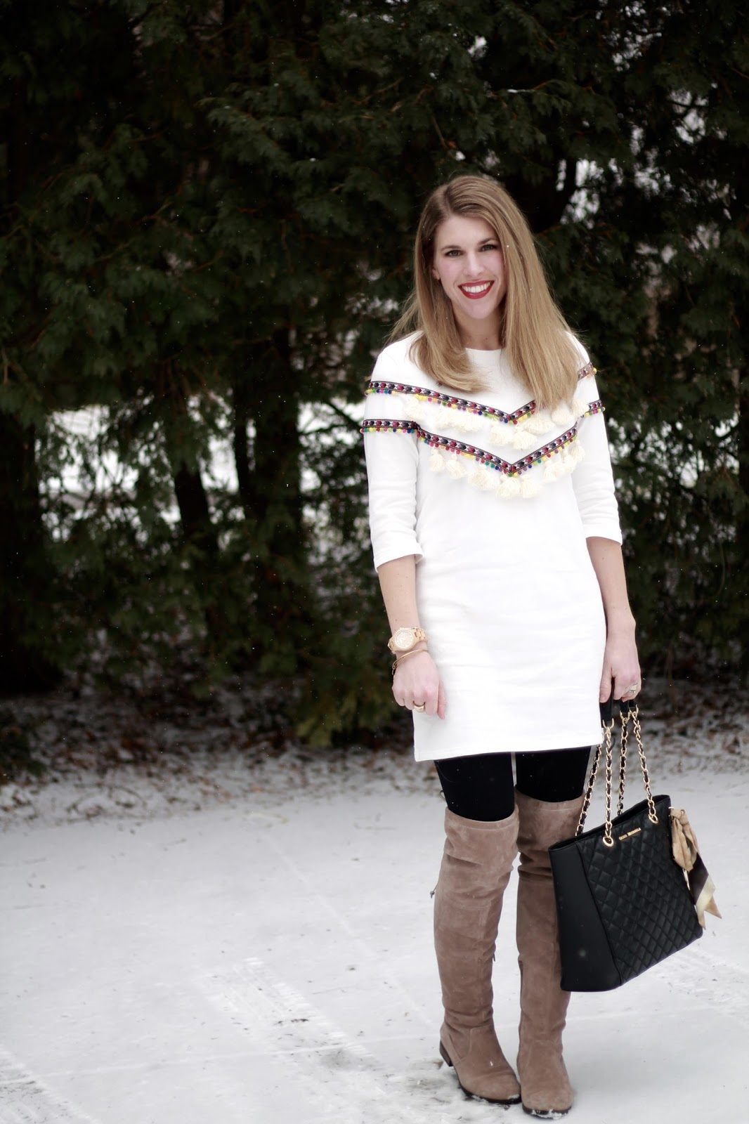 white pom pom tassel tunic, black leggings, OTK taupe boots, black quilted tote