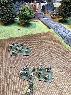 The British Lewis gun and rifle grenadiers take up position on the left flank of the hamlet