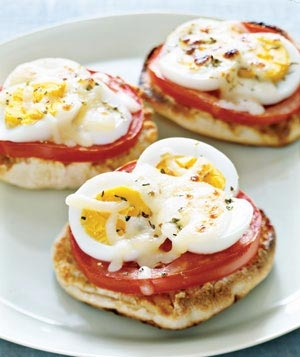 These mini English muffin pizzas topped with hard boiled eggs and tomatoes are delicious.