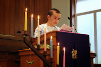 a youth reads scripture from the pulpit at youth-led worship