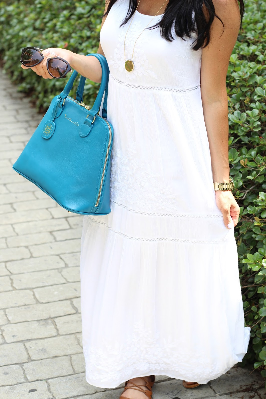 White embroidered maxi dress, turquoise bag, prada sunglasses