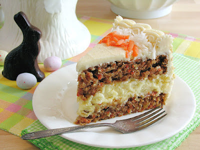 http://wickedgoodkitchen.com/carrot-cake-cheesecake-cake-bakery-style/