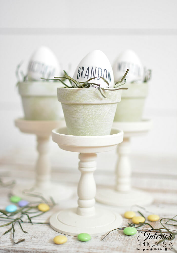 Gorgeous budget-friendly Rae Dunn inspired Easter egg place card holders with French Country style with repurposed dollar store mini terracotta pots.
