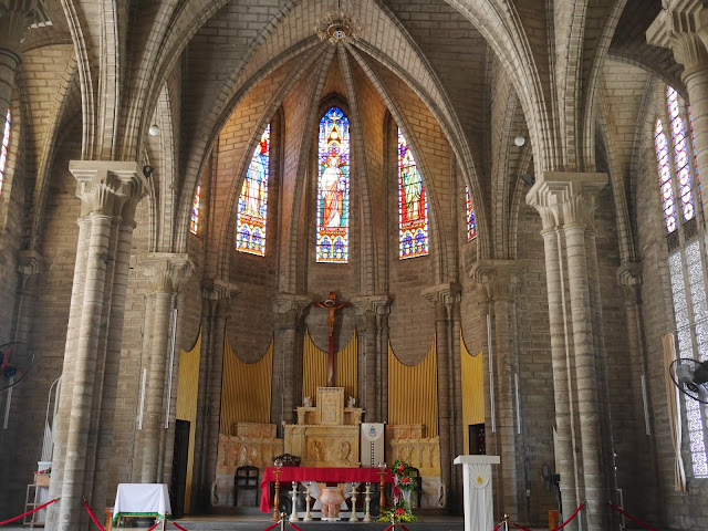the altar and stained glass windows of Christ the King Cathedral in Nha Trang, Vietnam