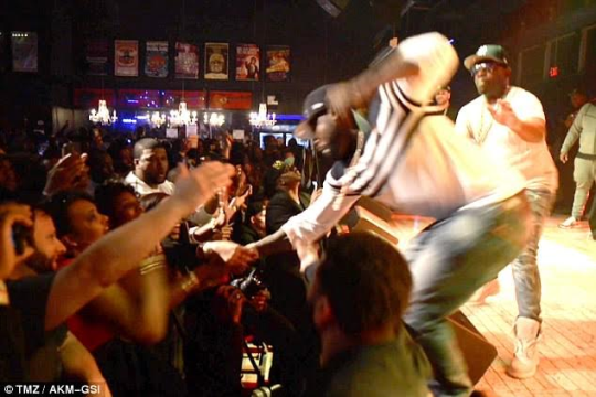 50 Cent Punches Female Fan As She Pulls Him Off Stage