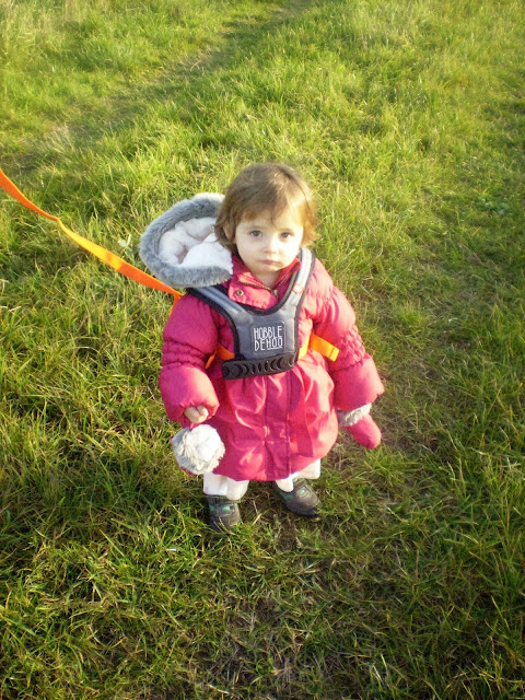 Eldest wearing the Hobbledehoo and standing in a field