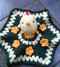 http://www.ravelry.com/patterns/library/eggbert-the-easter-chicken-lovey---comforter