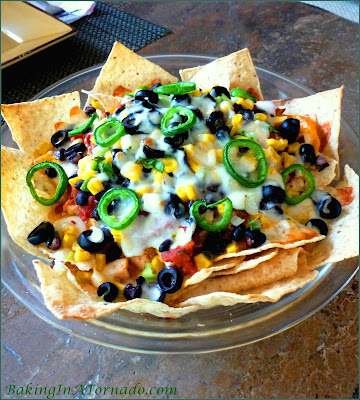 Chipotle Ranch Chicken Nachos, dinner, marinated chicken, lots of toppings and two different melted cheeses. Nachos aren't just for an appetizer any more. | Recipe developed by www.BakingInATornado.com | #recipe #dinner #chicken