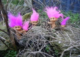 Picture of trolls in a forest bush.