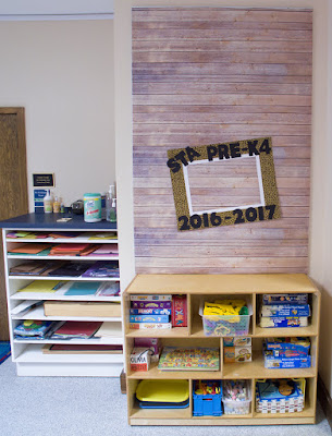 Use a bulletin board in a common area as a photo booth for Back to School pictures.