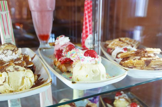 sundaes, milkshakes and desserts in a fridge