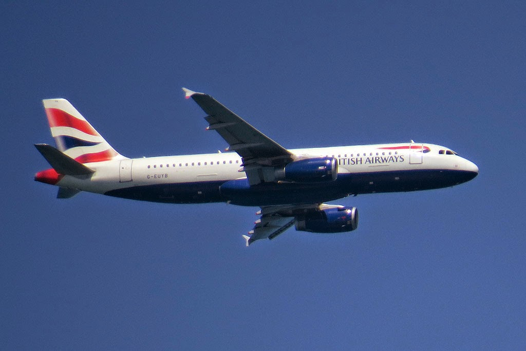 British Airways Airbus A318-321 G-EUYB, over the port of Livorno