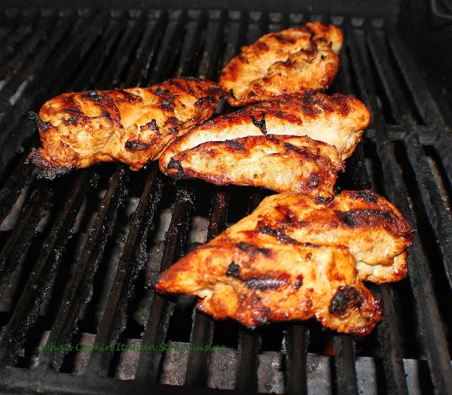 chicken grilled rubbed with olive oil with a good char marking on them