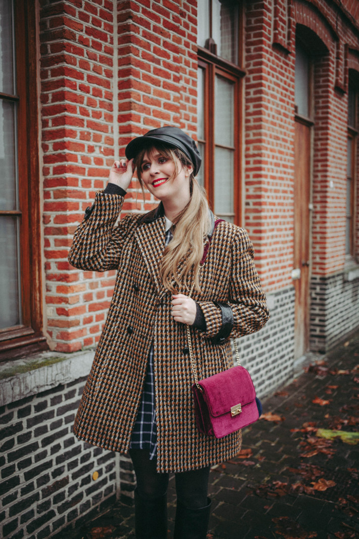 tweed coat, velvet purse, polkadot tights, leather fiddler cap