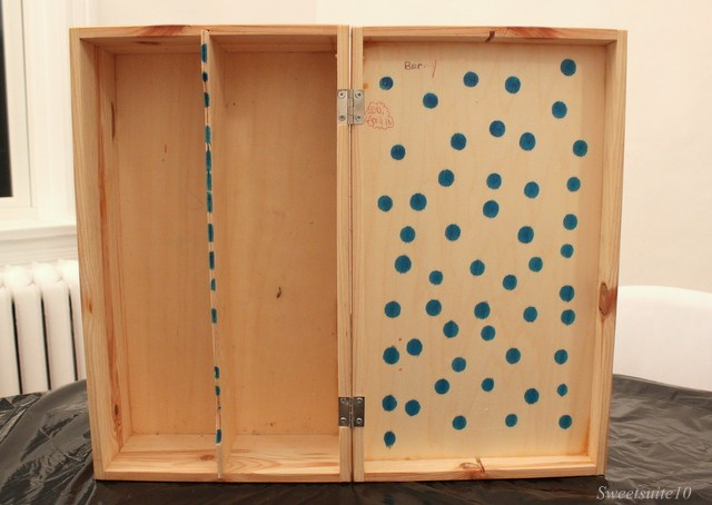 interior of a wood box decorated with polka-dots