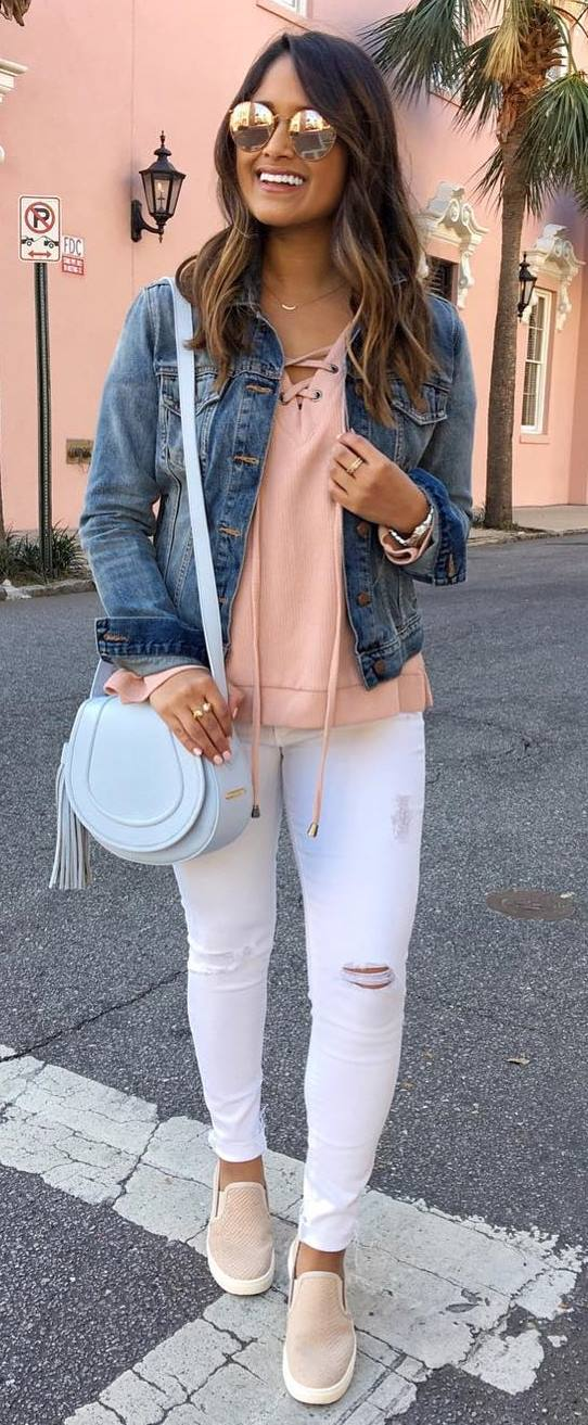 casual style perfection: denim jacket + sweatshirt + bag + rips + sneakers